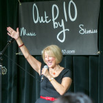 Out by 10 producer, Susan Seliger, raises her hand to the crowd.