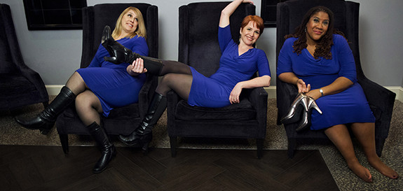 Reclining in blue, the ESP Vocal Trio kicks back and relaxes before the Out by Ten show.