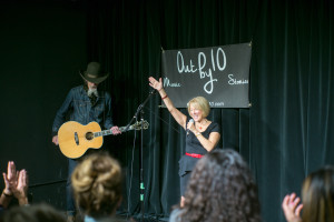 Out by 10 producer, Susan Seliger, raises her hand to the crowd Nov. 2015.