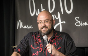 SMiling at the mic at Out by 10, Jeff Simmermon proves again he's a funny guy.
