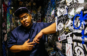 At out by 10, Gastor Almonte tells funny stories and stands next to graffiti wall