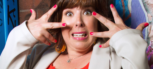 At Out by 10 carolyn Castiglia tells funny stories, with red fingers (by Phil Provencio)