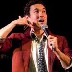 AT Out by 10, Mark Normand in a red jacket tells funny tales