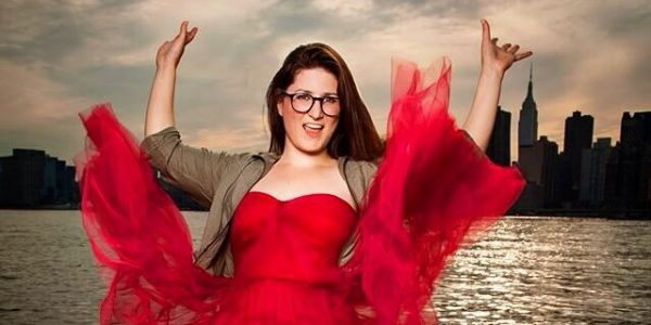 AT Out by 10 Kat Burdick put her red dress on to tell funny stories.